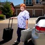 Paramedical examiner Denise Teifel brings several suitcases of equipment on her house calls.  Photo by: Robbie McClaran