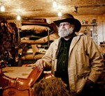 Saddle maker, Mark Nelson, in his home workshop in Boyceville, Wisc.  Sean McCormick