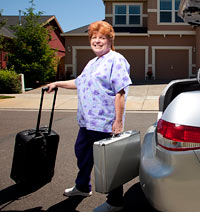 Paramedical examiner Denise Teifel brings several suitcases of equipment on her house calls. — Photo by: Robbie McClaran